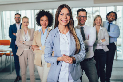 Happy business people and company staff in modern office